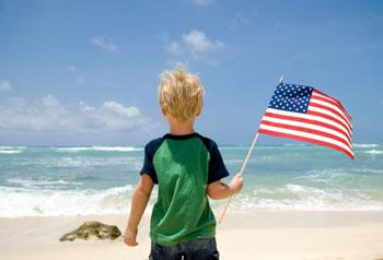 Child holding US flag
