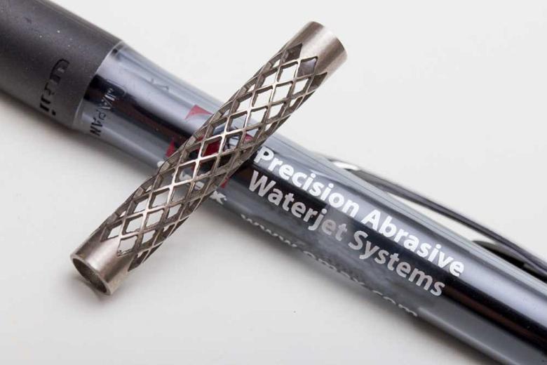 Rotary axis cut titanium tube