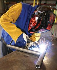 Welder  helmet into ready position