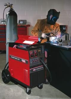 Man welding with Lincoln Electric power source.
