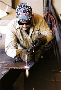 worker using an oxyfuel cutter