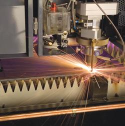 Laser lens cleaning