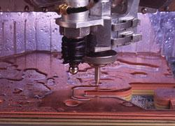 Waterjet cuts stacked material